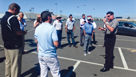 Phil Moser (arm raised) gives driving tips at a NAFA Pacific Southwest Chapter Fleet Management...