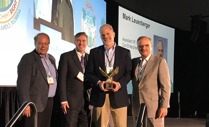 Mark Leuenberger (second from the right) accepts the Fleet Executive of the Year Award at the AFLA Conference awards ceremony in 2018. From left to right are Mike Antich of Automotive Fleet; John Wysseier of The CEI Group; Leuenberger; and Wayne Smolda of The CEI Group. The CEI Group is the exclusive sponsor for the Fleet Executive of the Year award. 