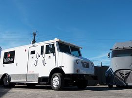 XOS first produced the prototype fully electric semi called the ET-One (right) but is now focused on last-mile delivery applications. The white Class 6 delivery truck is in a pilot for Loomis, a cash-in-transit provider.
