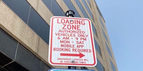 Instead of a jumble of street signs, fleet drivers in Omaha scan a QR code on a placard to...