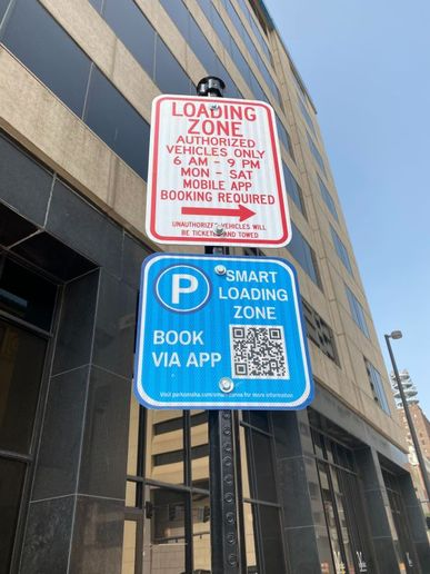 Instead of a jumble of street signs, fleet drivers in Omaha scan a QR code on a placard to access rules and information for that space. They can place a hold on that space, pay for, and extend their time through a downloaded app. - Photo by Doneliza Joaquin/Coord.