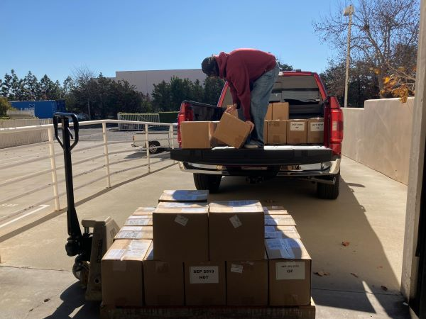 We loaded the truck with 55 boxes ofold magazines for a 1,732-lb. payload to test performance and fuel economy. - Photo by Chris Brown.