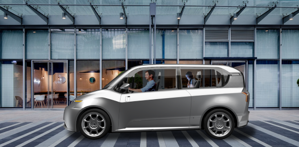 The purpose-built Indigo EVs will come in two variants initially, a four-wheel microvan (pictured) and a three-wheel delivery vehicle. Both are designed with a center driver seat, a removable rear bench seat, and two sliding doors for ingress and egress from either side. - Image courtesy of Indigo Technologies.