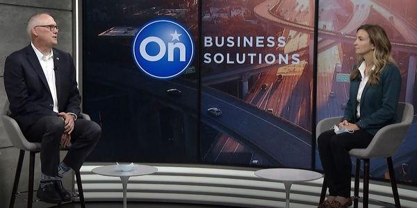 Ed Peper, head General Motors Fleet, and Michelle Calloway, director of OnStar Business...