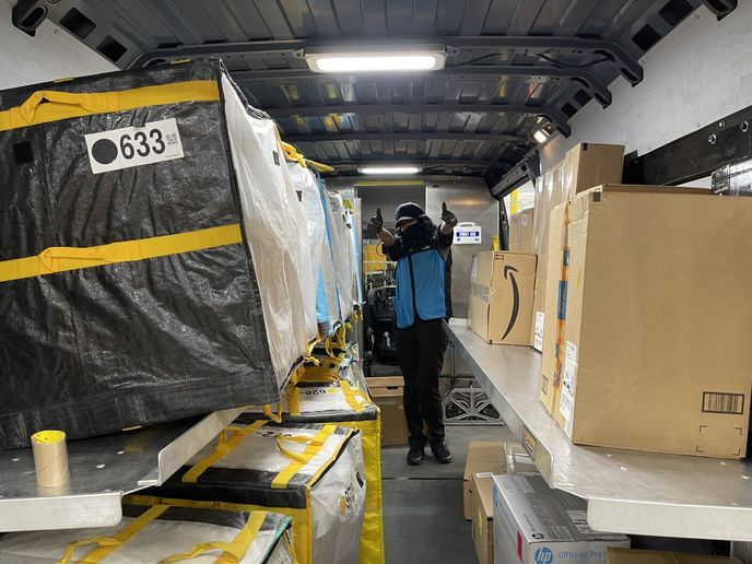 At the beginning of her day, Brown only has 20 minutes to scan and load the 300+ packages into her van in the proper order that corresponds with her delivery route. - Photo courtesy of Jeb Lopez.