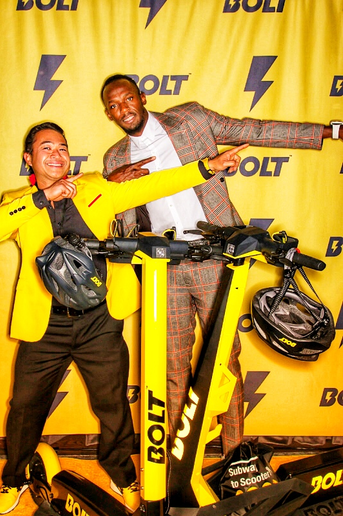 Jeb Lopez (left), owner and founder of an auto parts delivery service, was tapped to bring his fleet management expertise to Bolt Mobility's e-scooter service, fronted and funded by track star Usain Bolt.