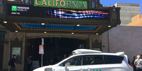 The Waymo autonomous minivan is parked outside the California Theater, site of TechCrunch's TC...