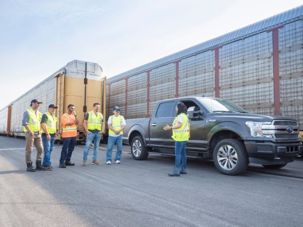 Ford showed the capability of a prototype all-electric F-150 last year by towing 10 double-decker rail cars.   - Photo courtesy of Ford.