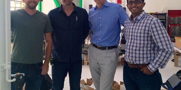 Investor Steve Jurvetson (blue shirt) meets with the Zoox cofounders at their global...