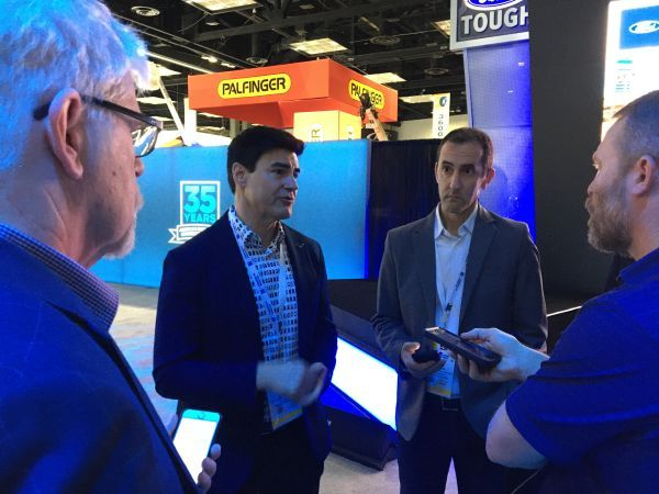Ted Cannis, global director of electrification for Ford, discusses the all-electric Transit with reporters at the 2020 Work Truck Show.  - Photo by Chris Brown.