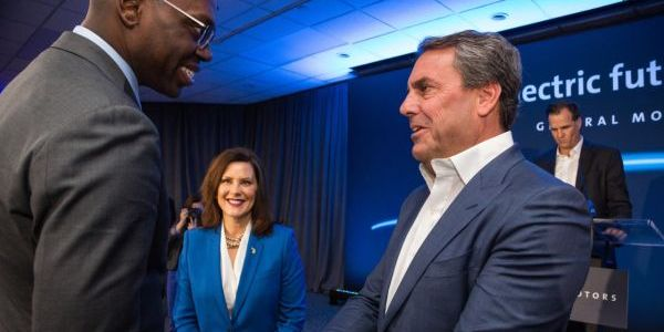Mark Reuss (right), GM president, greets Michigan Lt. Governor Garlin Gilchrist and Michigan...