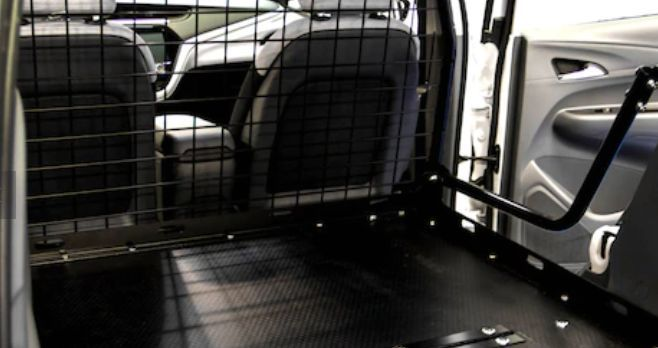 Adrian Steel offers a standard Bolt EV Cargo upfit that consists of a crossover-style partition and 1/8-inch thick pliable floor mats. -