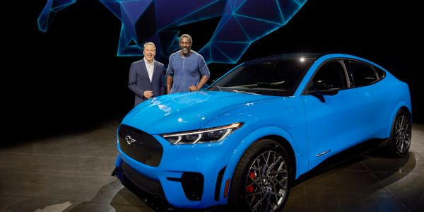 Ford Motor Company Executive Chairman Bill Ford, left, and actor Idris Elba next to Ford Motor...