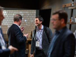Jordan Ramer of EV Connect interacts with an attendee. Ramer took part in a discussion electric...