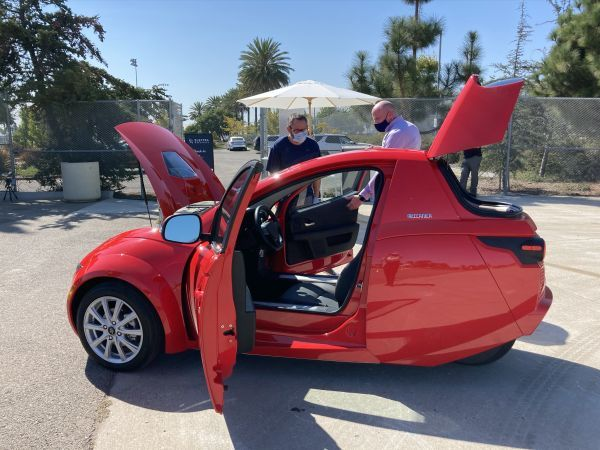 <p>ElectraMeccanica CEO Paul Rivera (right) demonstrates Solo's double-door entry to fleet editor Chris Brown.</p>[|CREDIT|]<p><em>Photo courtesy of ElectraMeccanica.</em></p>