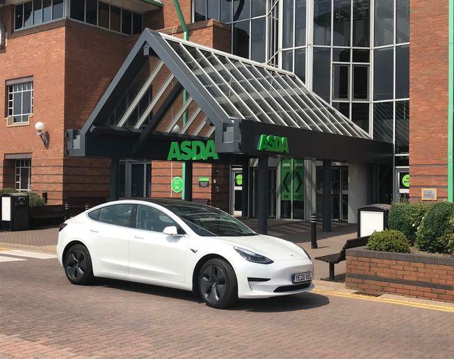 A Tesla Model 3, part of Asda's electric fleet, outside the Asda headquarters. - Credit: Asda