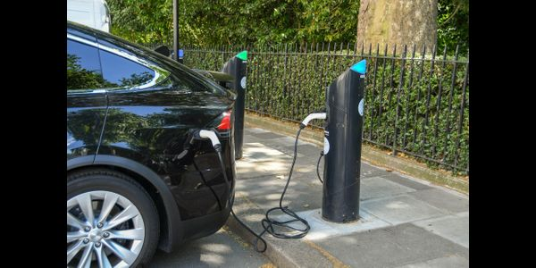 An electric car charging at a street charger. The AFP sees widespread deployment of on-street...