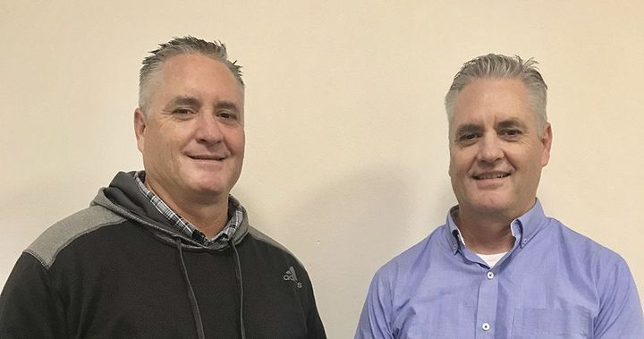 In the family: Dan Sunseri (right) worked with his twin brother until this year. Don Sunseri (left) was the fleet's senior automotive equipment specialist. The brothers both reported to the deputy director of public works, and Don retired in August. 