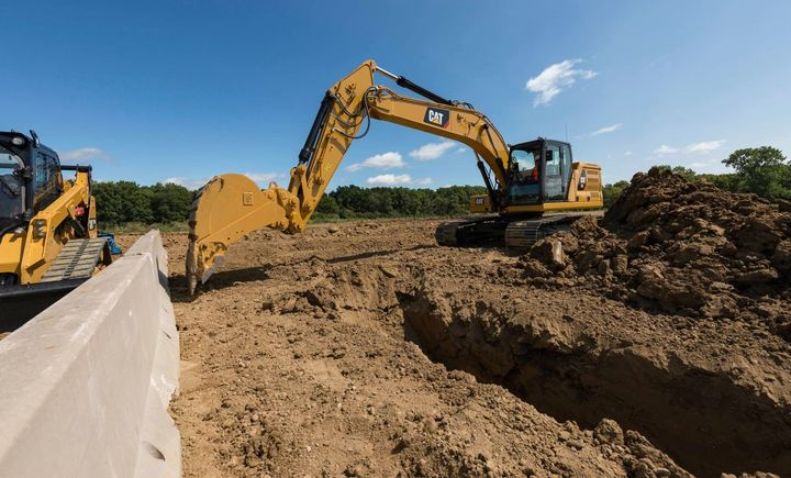 Caterpillar's 20-ton and 36-ton excavators include an e-fence feature, which helps the machines work safely under structures or near traffic. - Photo courtesy of Caterpillar