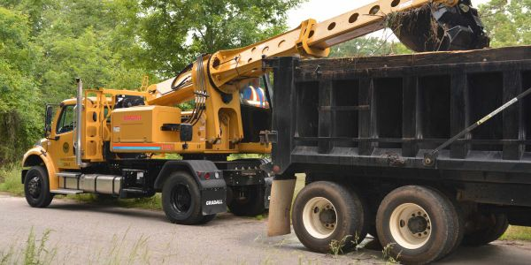 "The ""crossover excavator,"" built on a Freightliner chassis, features maneuverability that..."