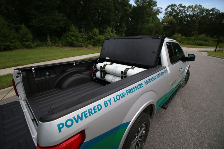 This F-150 plug-in hybrid adsorbed natural gas bi-fuel vehicle has a compressed natural gas range of about 80 miles before switching to gasoline. 