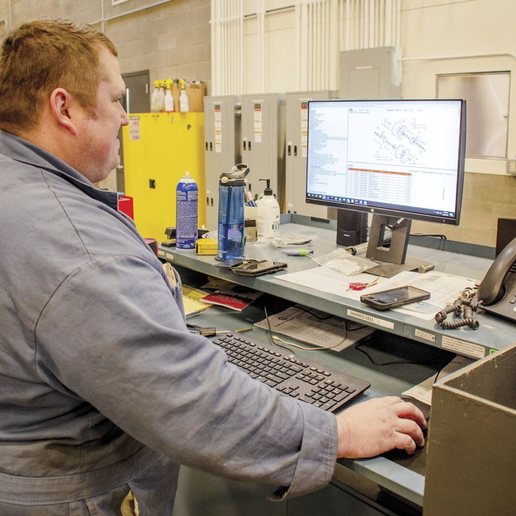 Herb Gross, a technician at Pierce County, Wash., opens and completes work orders.