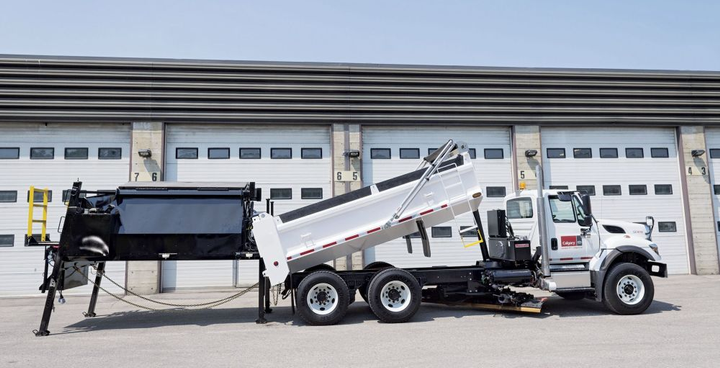 The City of Calgary fleet team in Canada developed a piece of equipment that allows road crews to recycle old asphalt. The asphalt carrier can be slipped onto a dump truck or stand alone.  - Photo courtesy of City of Calgary