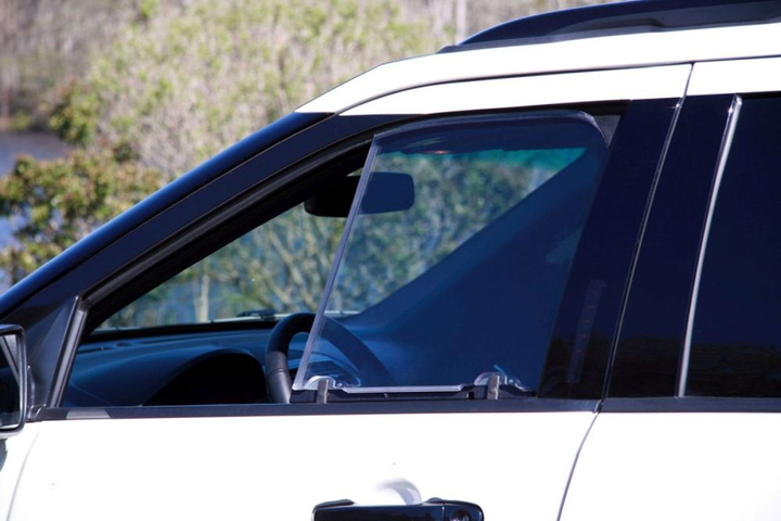 Patrol vehicle window armor partially covers the window, protecting the officer while allowing the officer to use the window for speaking to people and other operations.