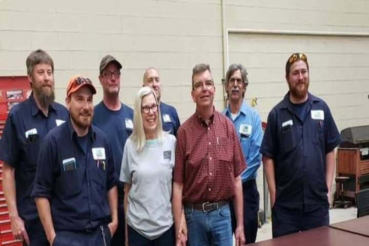 Bruce Halliday (in red) is pictured here with the Rochester Hills fleet team on his last day of work. - Photos: City Of Rochester Hills, Bruce Halliday