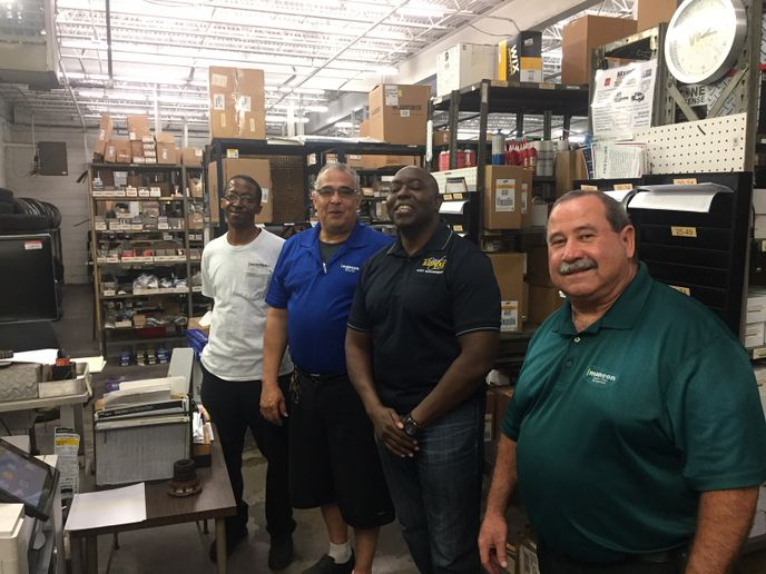 Gary Stewart (in the black City of Tampa polo), fleet analyst and contract manager for Contractor Operated Parts Store (COPS), stands with team members from MANCON, the City of Tampa, Fla., fleet department's parts provider. - Photo: City of Tampa, Fla.