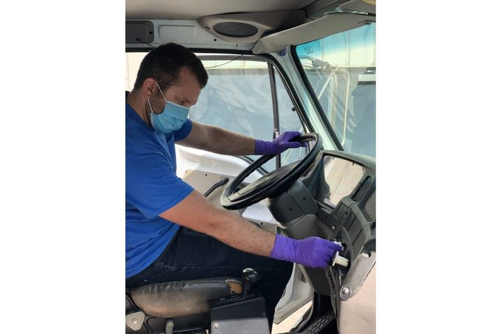 Chad Yeager of JEA thoroughly cleaning and sanitizing a vehicle. - Photo: JEA