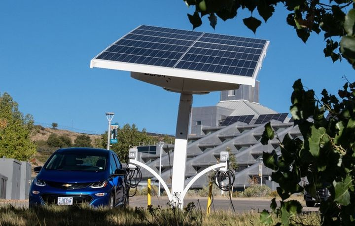 NREL expanded its fleet electric vehicle charging capabilities earlier this year with the installation of EV ARC 2020 (Electric Vehicle Autonomous Renewable Charger) on its campus in Golden, Colorado. - Photo by Dennis Schroeder, NREL