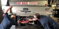 Nathan Peters and Pete Falish, both City of Green Bay, Wisconsin, mechanics, work together to learn from each other.