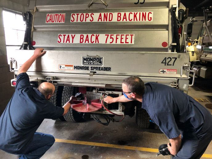 Nathan Peters and Pete Falish, both City of Green Bay, Wisconsin, mechanics, work together to learn from each other. - Photo:City of Green Bay DPW