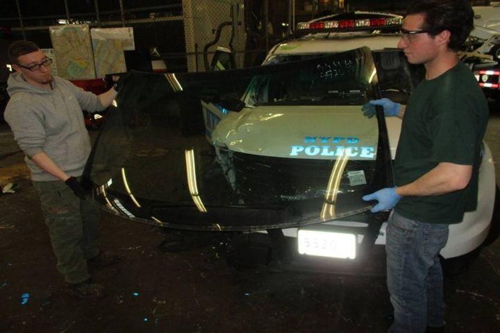 A trained team began removing glass out of already salvaged vehicles to assist in the repair of the ones damaged during protests. - Photo: NYPD
