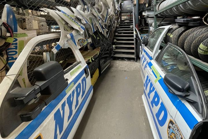 NYPD Fleet Services Deputy Director Michael Gorgia, who's responsible for the OEM parts the department purchases, built a salvage cage where parts like fenders, bumpers, hoods, glass, and doors are kept ready and waiting to be reused. - Photo: NYPD