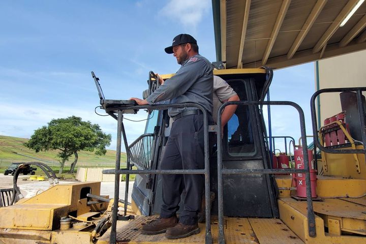 Fleet Technician Supervisor David Alligood works with another technician to diagnose a compactor at the Manatee County, Florida, landfill operation. - Photo:Manatee County, Florida