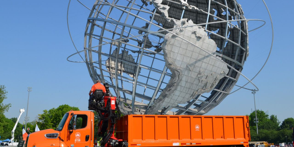 A Parks Department forestry log loader is pictured here in front of the Unisphere in Queens, New...
