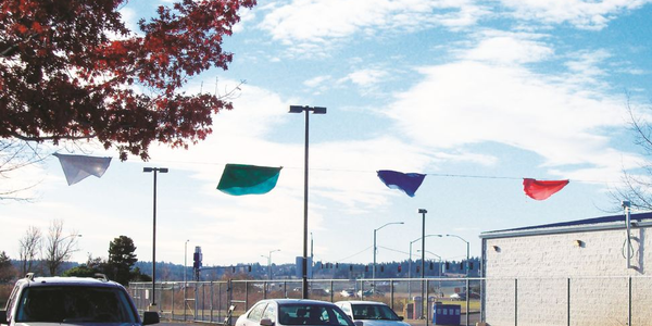 "Vehicle return lanes have color-coded flags, pictured here during a ""lean event."" Vehicle..."
