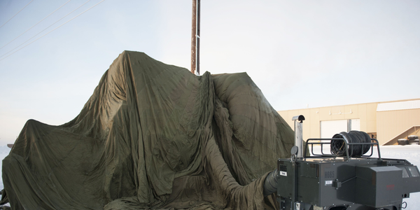 Members of the 354th Logistics Readiness Squadron vehicle maintenance shop work to repair a...