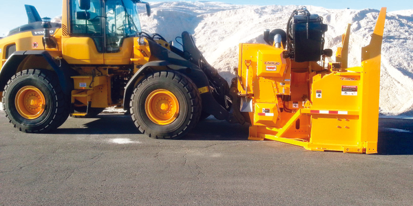 The City of Boston's snow fighting fleet includes this loader with a snow blower attachment....