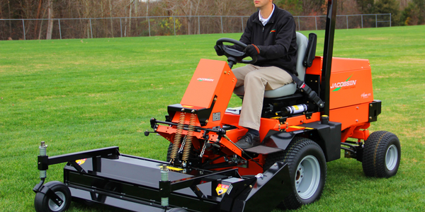 A flail deck attached to Jacobsen's TurfCat discharges grass and debris down into the turf with...