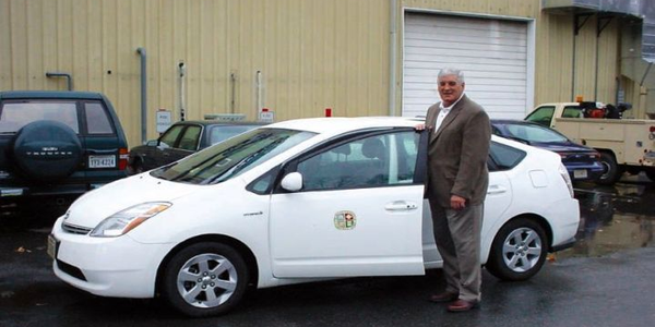 Fleet Manager Jim McClung shows off the City's Toyota Prius.