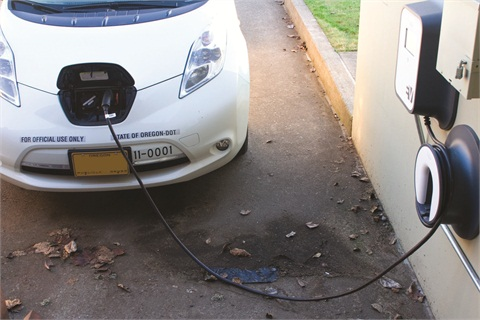 """Lowered vehicle prices have allowed state agencies to purchase more """"green"""" vehicles, including the Nissan Leaf operrated by the Department of Transportation. Photo courtesy State of Oregon."""
