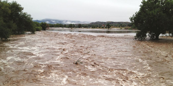 The Big Thompson River, located 80 yards from the City of Loveland, Colo., fleet facility,...