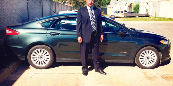 Detroit Executive Fleet Manager Craig Rice is pictured here with one of the new 2015 Ford Fusion...