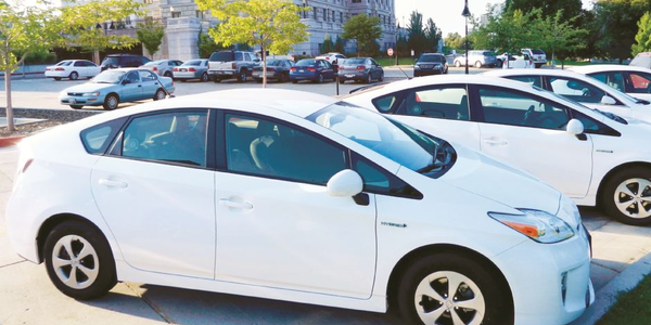 Utah replaces about 500 fleet vehicles annually. Pictured are some of its sedans.Photo courtesy...