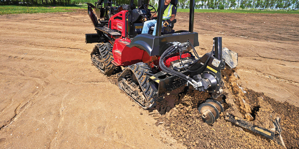 The Toro RT1200 riding trencher, shown here without the cab, is geared for mid- to long-range...