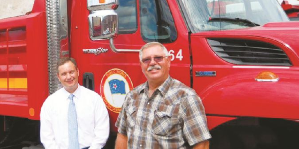 Bill McCarty, director, Office of Budget and Management (left) is pictured with Fleet Director...