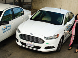 Reyna Ayala with the East Orange County (Calif.) Water District is one of the Ford Fusion plug-in vehicle's most frequent users, helping increase utilization of the EV. Photo courtesy of EOCWD